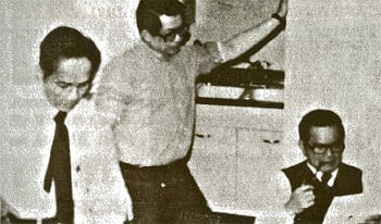"Raul Manglapus, Benigno ""Ninoy"" S. Aquino Jr, and Salvador Laurel, preparing Ninoy's arrival statement."