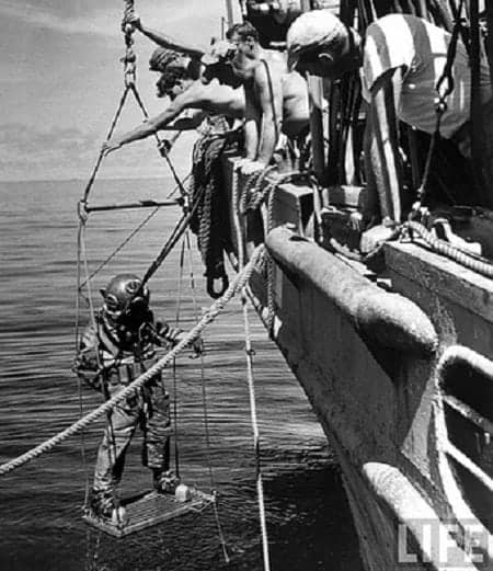 A diver searching for silver coins in Caballo Bay