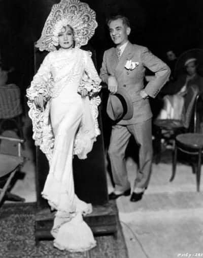 Manuel L. Quezon poses with Marlene Dietrich on the set of The Devil Is a Woman