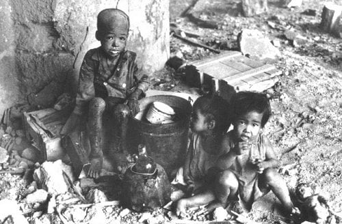 Filipino children homeless amid WWII wreckage