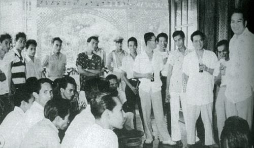 President Magsaysay seen on far right having a consultative session with jeepney drivers