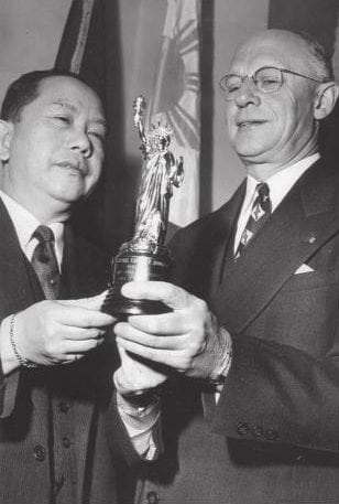 Chief Scout Executive Arthur A. Shuck presented Carlos Romulo with a miniature of the Statue of Liberty